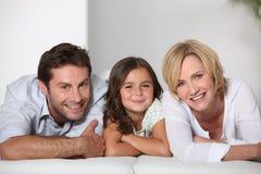 Padres con la hija Fotos de archivo