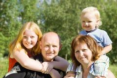 Padres con los niños Imagenes de archivo