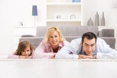 Padres e hija felices Imagen de archivo libre de regalías