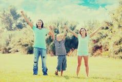 Padres felices con el hijo adolescente Imágenes de archivo libres de regalías