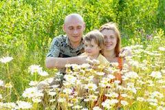 Padres felices con el niño Imágenes de archivo libres de regalías