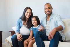 Padres felices con la hija Imagen de archivo libre de regalías