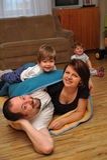 Padres felices en juego con sus niños Fotografía de archivo libre de regalías