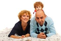 Padres felices y su hija Imágenes de archivo libres de regalías