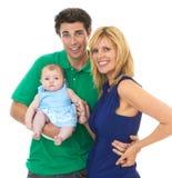Padres jovenes orgullosos con el bebé foto de archivo libre de regalías