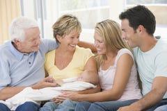 Padres y abuelos con el nieto Imágenes de archivo libres de regalías