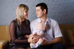 Padres y bebé Imagen de archivo libre de regalías