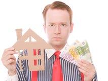Padrone di casa serio di affari con soldi immagine stock libera da diritti