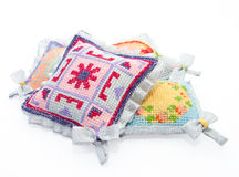 The  pads beautifully decorated. The  pads  for pins beautifully decorated with handmade embroidery Stock Image