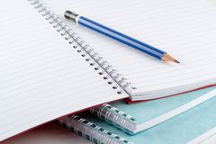 Pads and Pencil. Spiral notepads and a pencil Royalty Free Stock Images