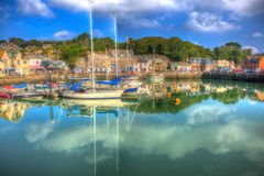 Padstow Cornwall England UK with boats in brilliant colourful HDR. Padstow harbour North Cornwall England UK with boats on calm day in brilliant colourful HDR Royalty Free Stock Photo
