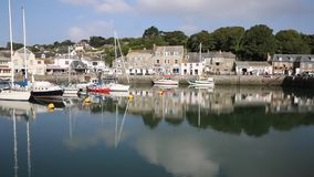 Padstow harbour and boats North Cornwall England UK beautiful late summer sun and calm fine weather PAN stock video