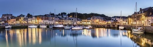 Padstow Harbour at Dusk, Cornwall. With reflections of the boats and lights in and around the harbour royalty free stock photos