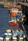Padstow harbour fishing boats. A row of fishing boats moored alongside the harbour wall at Padstow, Cornwall, UK stock image