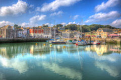 Padstow harbour North Cornwall England UK with boats in brilliant colourful HDR. Padstow harbour North Cornwall England UK with boats on calm day in brilliant Stock Photography