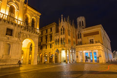 Padua - The Caffe Pedrocchi and part of Palazzo del Podesta at night. Stock Photos