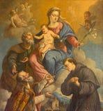 Padua - den heliga familjen och helgonen Nicholas och Anthony av Padua av den okända målaren av 18 cent i kyrkan av St Nicholas Arkivbilder