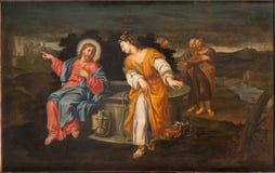 PADUA, ITALIA - 10 DE SEPTIEMBRE DE 2014: Pintura de Jesús y de samaritanos en la escena bien en la iglesia Chiesa di San Cayetan Imagenes de archivo