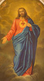 PADUA ITALIEN - SEPTEMBER 8, 2014: Hjärtan av Jesus Christ målarfärg från sidoaltaret i den kyrkliga San Benedetto vecchioen Arkivbild