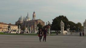 PADUA, ITALY - OCTOBER, 2017: Piazza Prato della Valle on Santa Giustina abbey. Prato della Valle elliptical square with. A green island the center, surrounded stock footage