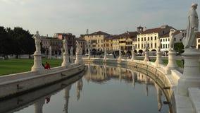 PADUA, ITALY - OCTOBER, 2017: Piazza Prato della Valle on Santa Giustina abbey. Prato della Valle elliptical square. With a green island the center, surrounded stock video footage