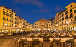 Padua -  Piazza dei Signori square with the church of San Clemente in the background in evening dusk. Royalty Free Stock Photo