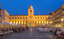 Padua - Piazza dei Signori square and Torre del Orologio (astronomical clock tower)  in the background in evening dusk. PADUA, ITALY - SEPTEMBER 11, 2014 Stock Photos