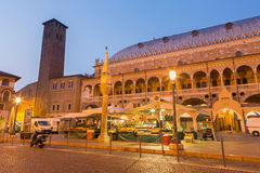 Padua - Piazza della Fruta in morning dusk with the market and Palazzo dalla Ragione. Royalty Free Stock Photos