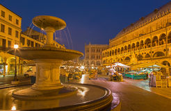 Padua - Piazza delle Erbe in morning dusk with the market and Palazzo dalla Ragione. Stock Photos