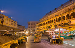Padua - Piazza delle Erbe in morning dusk with the market and Palazzo dalla Ragione. Stock Photography
