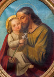 Padua - The saint Joseph with the child paint from side altar in church Basilica del Carmine. The saint Joseph with the child paint from side altar in church Royalty Free Stock Image