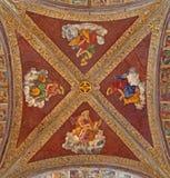 Padua - takfreskomålningen i kyrkliga San Francesco del Grande med evangelisten fyra i kapellet Santa Maria della Carita Royaltyfri Fotografi