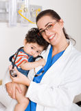 Paediatrician and baby Royalty Free Stock Photos