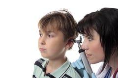 Paediatrician checking ears Stock Photos