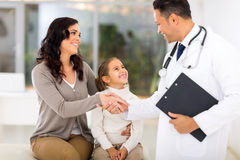 Paediatrician greeting patient Stock Photo