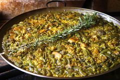 Paella. Pan with chicken and rabbit , cooked on wood stock image
