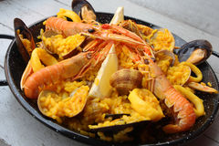 Paella. Spanish tradicional paella home-made composed of rice, and  fresh seafood like clams, king prawns and squid rings Royalty Free Stock Image