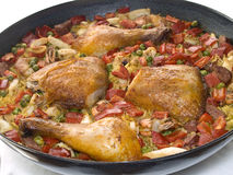 Paella. Saucepan filled with paella containing chicken legs and wings Stock Image