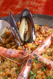 Paella. Spanish paella with rice, prawns and clams Royalty Free Stock Images
