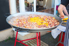Paella being cooked in a large pan Royalty Free Stock Photography