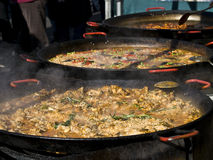 Paella in big pans Royalty Free Stock Image