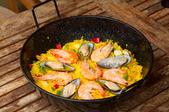 Paella in black pan Stock Photo