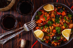 Paella with chicken, chorizo, seafood, vegetables and saffron. Stock Images