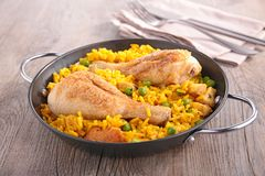 Paella with chicken leg and seafood Stock Images