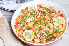 Paella with chicken, tomatoes and pepper . Traditional Spanish dish. Royalty Free Stock Image