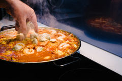 Paella with clams opening Stock Photos