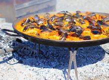 Paella cooking over hot coals Stock Images