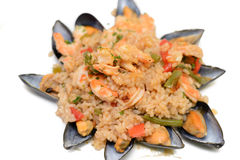 Paella. Detail of nice decorated paella - national spanil food on white background Stock Photos