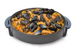 Paella dinner close up. Paella pot with various seafood stock photo