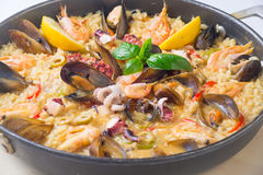Paella in dish from above. Stock Photo